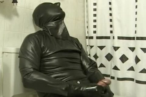 lad In dark Latex Catsuit Jacks Off In bathroom