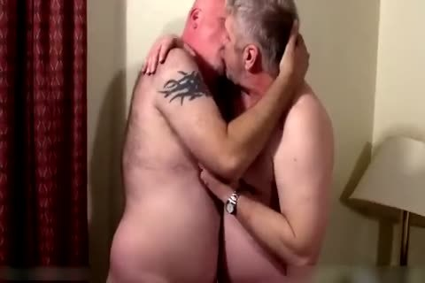 Two sexy daddies in bedroom