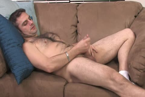 bushy dude Lays On The sofa And Starts Playing With His Hard Pole