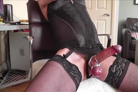 dark Corset, nylons, metallic Rings And cum