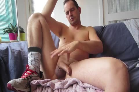 handjob In Front Of The Camera On The Sofa