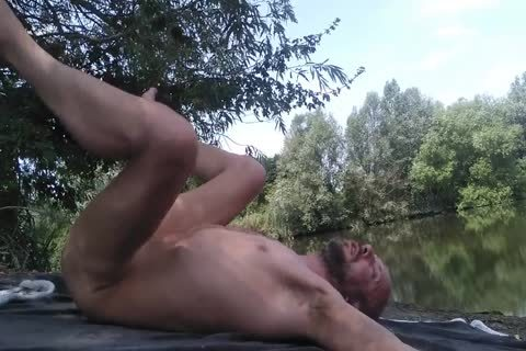 avid guy Masturbating Full stripped Near A Public Canal