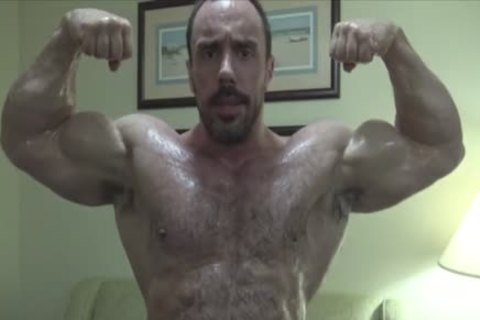 hirsute Muscle Hunk Oiling Up