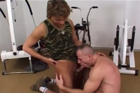 lustful homo Rides A Stationary Bike whilst Being fucked