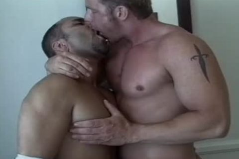 Tanned males enjoy An Intimate moment together