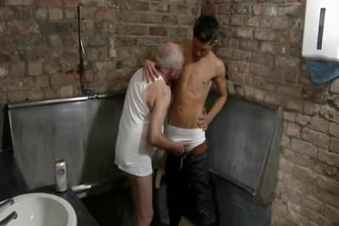 nice Looking grandad & young man engulf Each Other In A Public