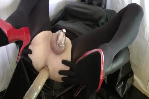 Sissy With Red Heels Is boned In A Chastity Belt