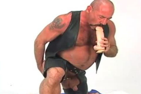 Butch leather wearing old guy w/ large fake penis