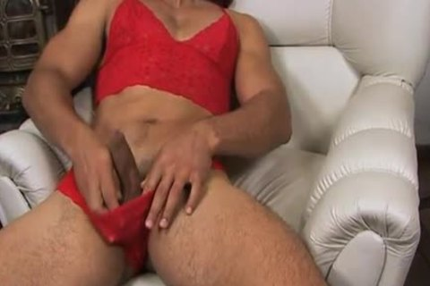 Blond cross dresser in red underware wanks off