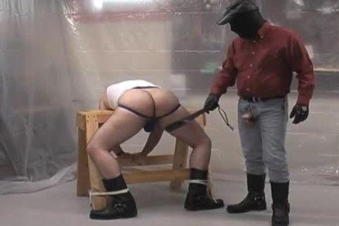 Masked corporalist naked ploughs his subordinate